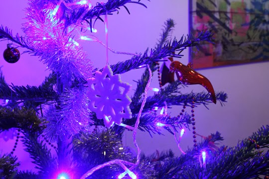 a close up of a christmas tree with blue lights