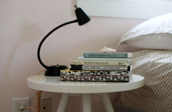 pile of books on a side table
