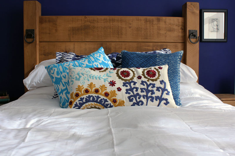 cushions on a dressed bed how to master interior design
