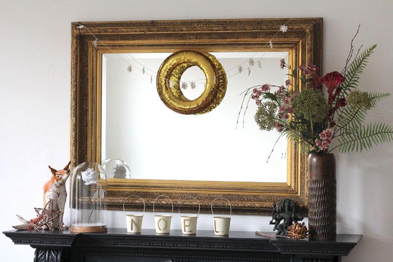 a wreath hung on a mirror craft diy