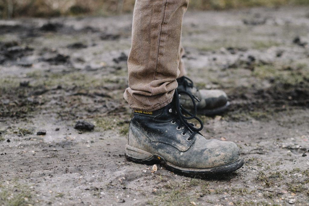 a pair of muddy boots why you should not wear shoes inside